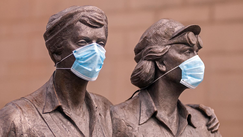 statues wearing Covid-19 masks