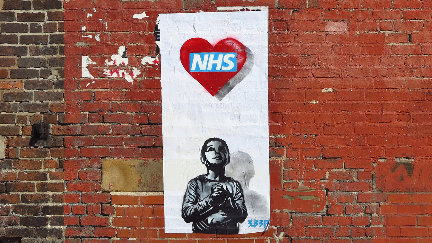 NHS heart poster on a wall