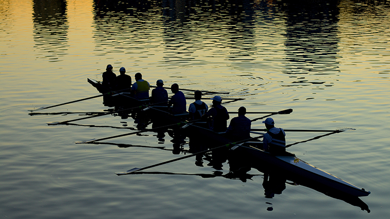 rowing crew on a river